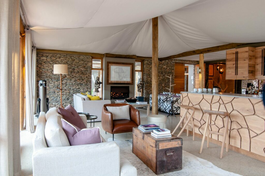 Relax with a drink at bar and lounge area at Dwyka Tented Camp in Sanbona Private Reserve