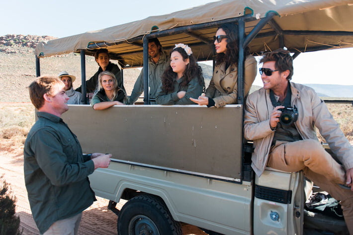 Clients on the safari vehicle at Aquila Private Game Reserve