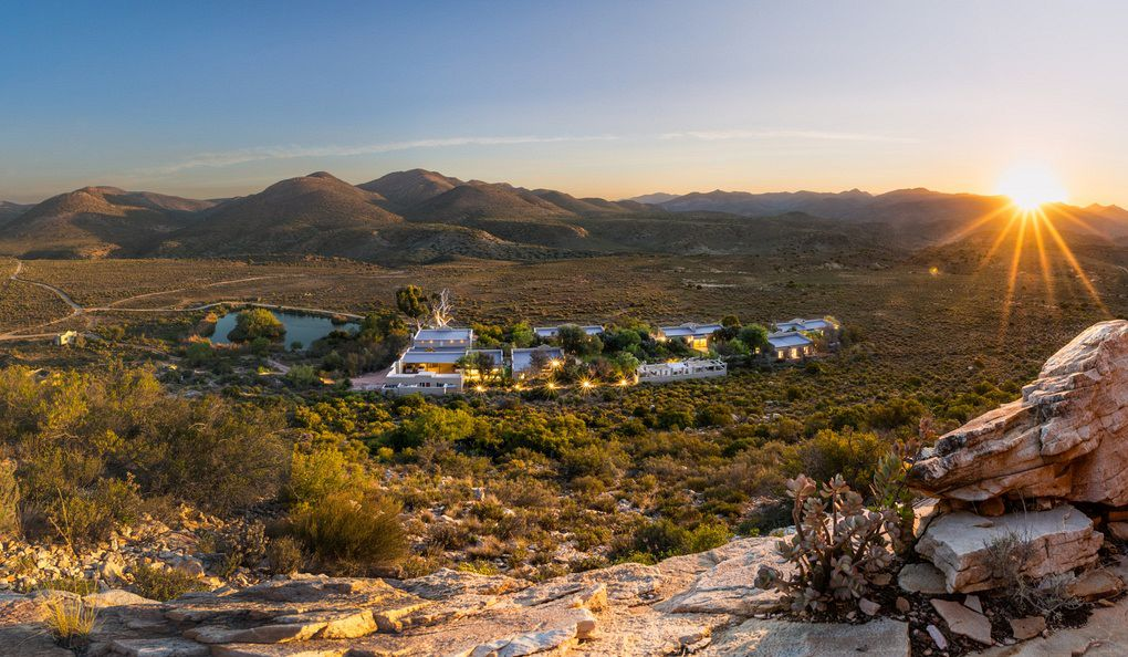 An aerial view of Tilney Manor at sunrise in the Sanbona Private Reserve
