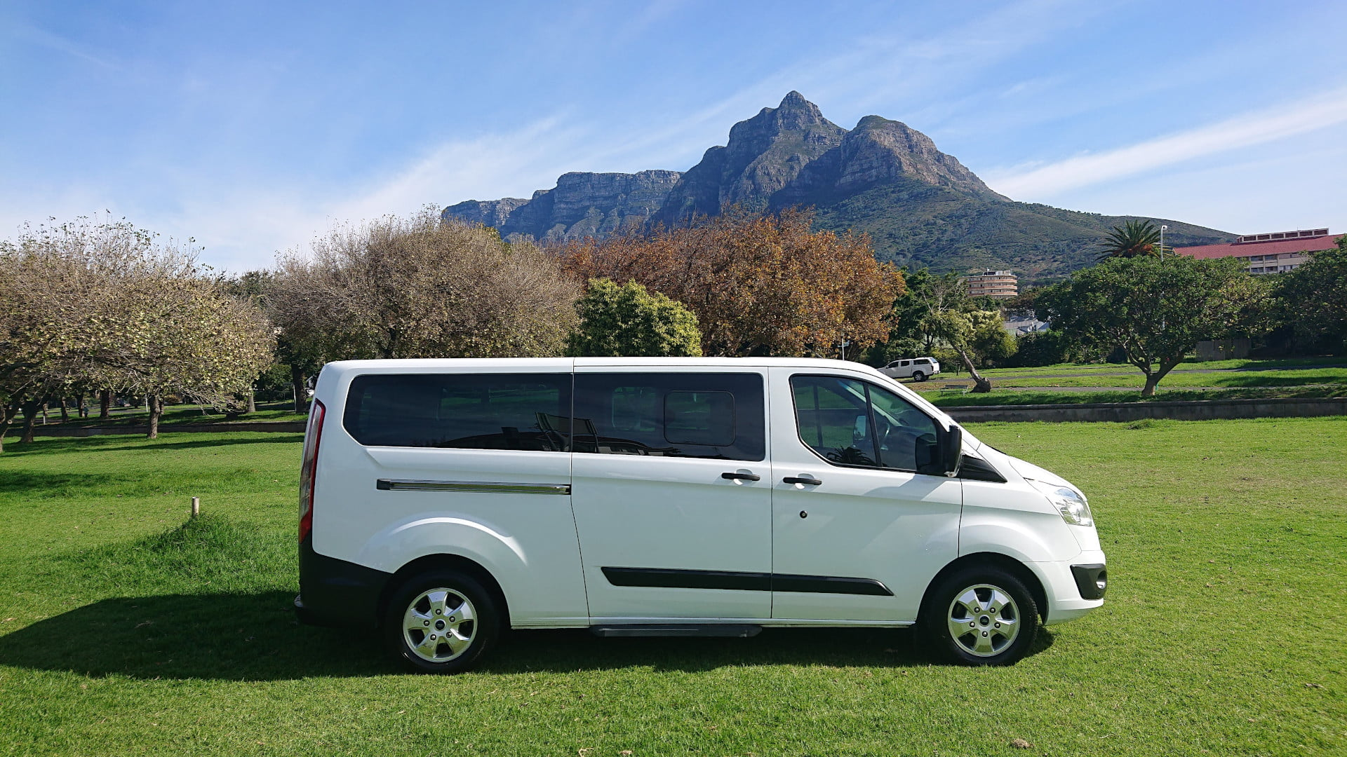 Side view of 7 Seater, air conditioned van